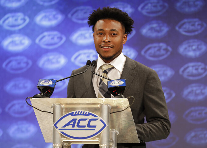 FILE - In this July 18, 2018, file photo, Georgia Tech's TaQuon Marshall answers a question during a news conference at the NCAA Atlantic Coast Conference college football media day, in Charlotte, N.C. The cost of attendance stipend is quietly helping college players while the debate rages on whether they should be paid. Marshall has heard from former players how essential budgeting was and appreciates not having to worry as much. (AP Photo/Chuck Burton, File)