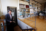 FILE - In this Feb. 12, 2015 file photo, co-founder of Japan's prestigious Studio Ghibli, Isao Takahata, appears in his office at Studio Ghibli in suburban Tokyo after an interview about his animated film