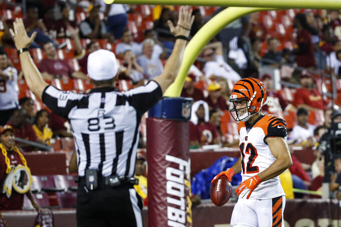 Cincinnati Bengals' Alex Erickson (12) smiles after returning a punt for a touchdown during the second half of the team's NFL preseason football game against the Washington Redskins, Thursday, Aug. 15, 2019, in Landover, Md. The Bengals won 23-13. (AP Photo/Alex Brandon)