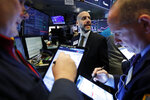 Specialist Meric Greenbaum, center, works with traders at his post on the floor of the New York Stock Exchange, during a secondary stock offering in Petrobras, Thursday, Feb. 6, 2020. (AP Photo/Richard Drew)