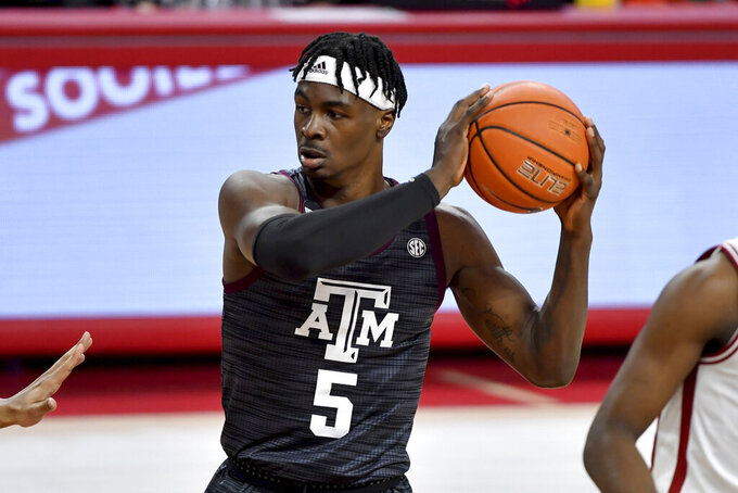FILE - Texas A&M forward Emanuel Miller (5) plays against Arkansas during an NCAA college basketball game in Fayetteville, Ark., in this Saturday, March 6, 2021, file photo. TCU has eight transfers this season, including Miller, who shot 57% at Texas A&M in the Southeastern Conference. (AP Photo/Michael Woods, FIle)