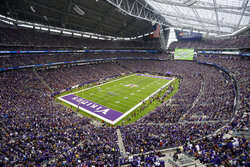 FILE - In this Sept. 8, 2019, file photo, fans cheer in U.S. Bank Stadium during the second half of an NFL football game between the Minnesota Vikings and the Atlanta Falcons, in Minneapolis. The Minnesota Vikings will play at least their first two home games without fans in attendance. With current Minnesota Department of Health guidelines specifying an indoor venue capacity of 250 people, officials from the Vikings, the state, U.S. Bank Stadium, the NFL and the city of Minneapolis were unable to establish a prudent way to open the gates to the public for now. The Vikings will host Green Bay on Sept. 13, 2020, and Tennessee on Sept. 27 with the 66,000 seats empty. (AP Photo/Bruce Kluckhohn, File)