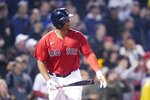 Boston Red Sox's Rafael Devers watches the flight of his winning RBI-single in the bottom of the ninth inning of a baseball game against the Toronto Blue Jays at Fenway Park, Monday, June 14, 2021, in Boston. (AP Photo/Charles Krupa)