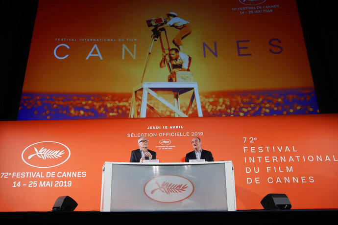 Festival director Thierry Fremaux, left, and festival president Pierre Lescure in front of the Cannes International Film Festival poster for the upcoming 72nd edition during a press conference to announce this years line up in Paris, Thursday April 18, 2019. The festival will run from May 14 to May 25, 2019. (AP Photo/Francois Mori)