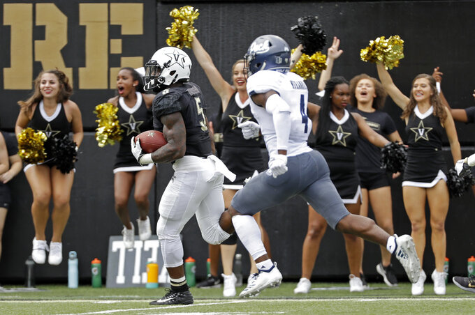 Vanderbilt running back Ke'Shawn Vaughn (5) beats Nevada defensive back EJ Muhammad (4) to the end zone as Vaughn scores a touchdown on a 46-yard run in the second half of an NCAA college football game Saturday, Sept. 8, 2018, in Nashville, Tenn. (AP Photo/Mark Humphrey)