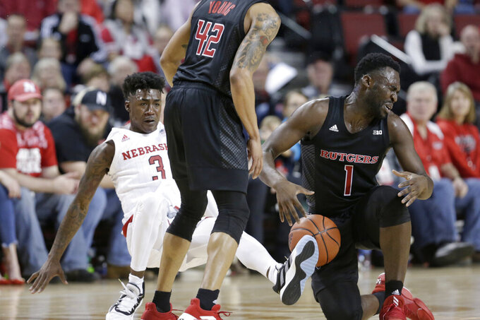 Nebraska's Cam Mack (3) and Rutgers' Akwasi Yeboah (1) collide next to Rutgers' Jacob Young (42) during the first half of an NCAA college basketball game in Lincoln, Neb., Friday, Jan. 3, 2020. (AP Photo/Nati Harnik)