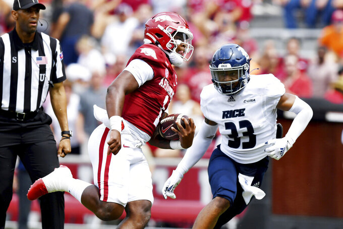 Arkansas quarterback KJ Jefferson (1) runs past Rice defender Myron Morrison (33) to score a touchdown during the first half of an NCAA college football game, Saturday, Sept. 4, 2021, in Fayetteville, Ark. (AP Photo/Michael Woods)