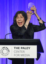 FILE - Honoree Lily Tomlin, right, celebrates receiving her award at
