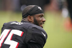 Atlanta Falcons linebacker Deion Jones (45) talks with other players during NFL football practice on Tuesday, Aug. 3, 2021, in Flowery Branch, Ga. (AP Photo/Brynn Anderson)