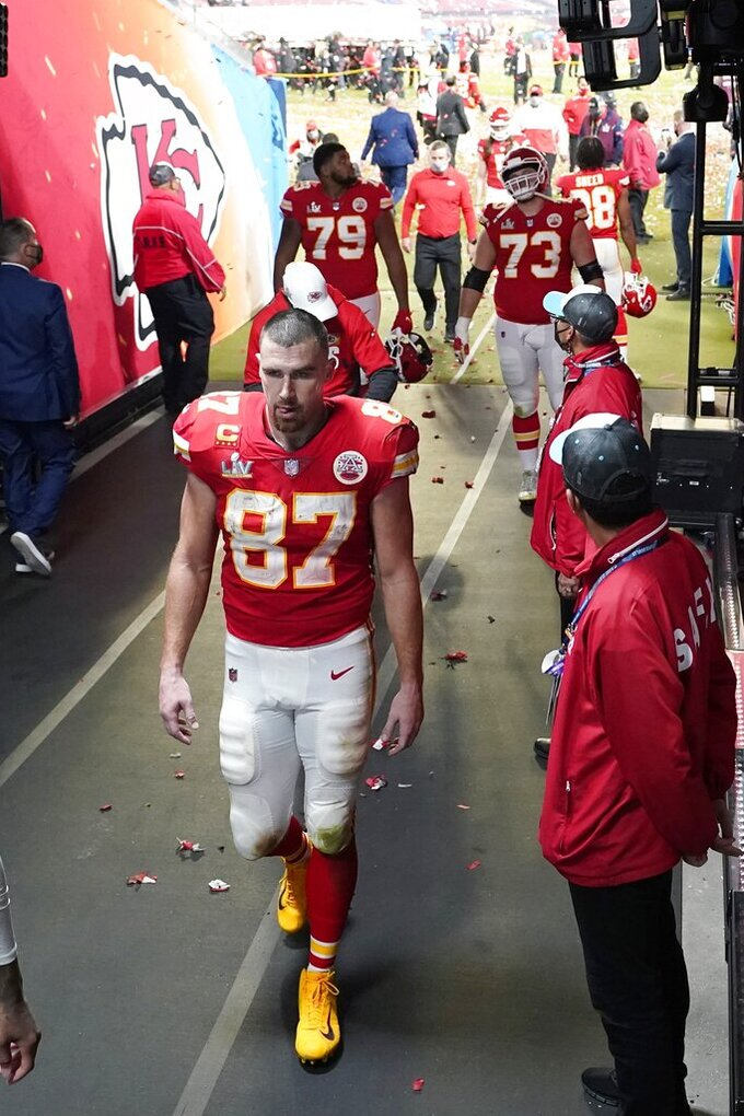 Kansas City Chiefs' Travis Kelce (87) walks to the locker room following the NFL Super Bowl 55 football game against the Tampa Bay Buccaneers Sunday, Feb. 7, 2021, in Tampa, Fla. The Buccaneers defeated the Chiefs 31-9 to win the Super Bowl. (AP Photo/David J. Phillip)