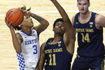 Kentucky's B.J. Boston (3) shoots while defended by Notre Dame's Juwan Durham (11) during the second half of an NCAA college basketball game in Lexington, Ky., Saturday, Dec. 12, 2020. Notre Dame won 64-63. (AP Photo/James Crisp)