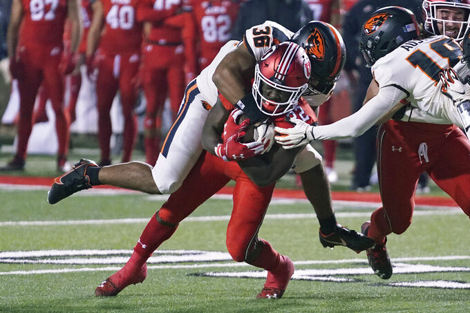Oregon State linebacker Omar Speights (36) tackles Utah running back Ty Jordan (22) during the first half of an NCAA college football game Saturday, Dec. 5, 2020, in Salt Lake City. (AP Photo/Rick Bowmer)
