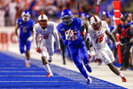 Boise State wide receiver John Hightower (16) turns upfield and runs away from the New Mexico defense for a 51-yard touchdown reception during the first half of an NCAA college football game Saturday, Nov. 16, 2019, in Boise, Idaho. (AP Photo/Steve Conner)