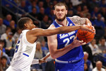 Seton Hall's Sandro Mamukelashvili (23) heads to the basket as Saint Louis' Demarius Jacobs defends during the first half of an NCAA college basketball game Sunday, Nov. 17, 2019, in St. Louis. (AP Photo/Jeff Roberson)