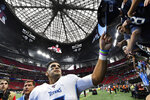 Tennessee Titans quarterback Marcus Mariota gives his hat to fans after an NFL football gameagainst the Atlanta Falcons, Sunday, Sept. 29, 2019, in Atlanta. The Tennessee Titans won 24-10. (AP Photo/John Amis)