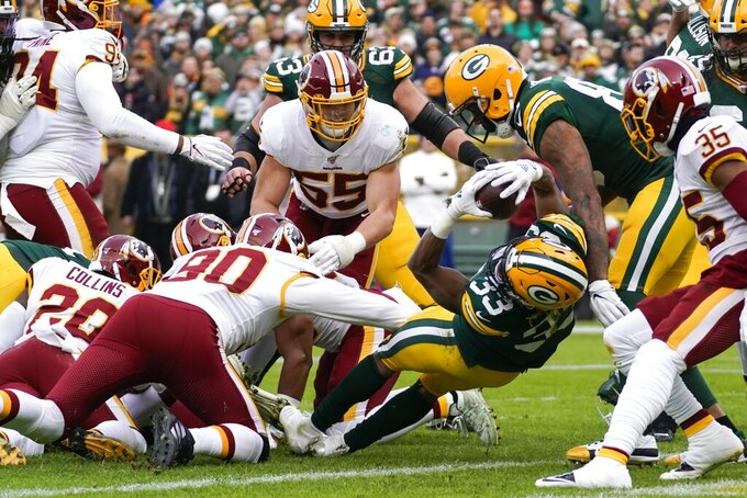 Green Bay Packers' Aaron Jones runs for a touchdown during the first half of an NFL football game against the Washington Redskins Sunday, Dec. 8, 2019, in Green Bay, Wis. (AP Photo/Morry Gash)