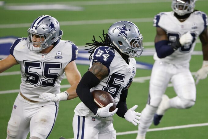 Dallas Cowboys linebacker Jaylon Smith (54) returns a Washington Football Team's Alex Smith interception for a long gain as Leighton Vander Esch (55) provides a block in the second half of an NFL football game in Arlington, Texas, Thursday, Nov. 26, 2020. (AP Photo/Ron Jenkins)