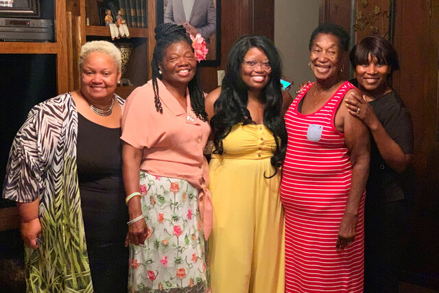 "In this photo provided by Steve Morgan, Mary Louise Brown Morgan, second from right, poses with relatives in the fall of 2019. The 78-year-old grandmother died March 27, 2020, after being diagnosed with the new coronavirus. Morgan was described by family members as a ""God-fearing woman,"" who made a ""mean gumbo and red beans,"" and loved to tend to her garden of rosebushes and fruit trees. (Steve Morgan via AP)"