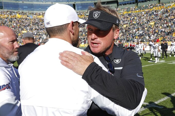 Green Bay Packers head coach Matt LaFleur talks to Oakland Raiders head coach Jon Gruden after an NFL football game Sunday, Oct. 20, 2019, in Green Bay, Wis. The Packers won 42-24. (AP Photo/Mike Roemer)