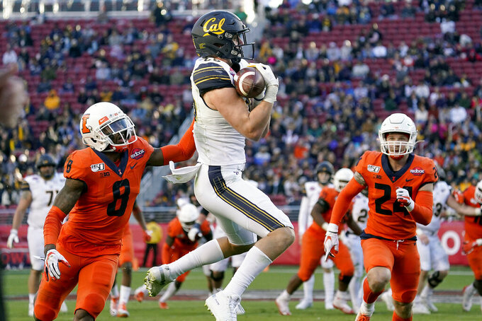 California tight end Jake Tonges (85) catches a pass against Illinois defensive back Nate Hobbs (8) during the second half of the Redbox Bowl NCAA college football game Monday, Dec. 30, 2019, in Santa Clara, Calif. (AP Photo/Tony Avelar)