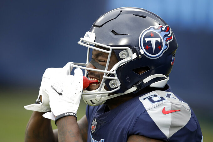Tennessee Titans wide receiver Corey Davis celebrates after scoring against the Detroit Lions during the first half of an NFL football game Sunday, Dec. 20, 2020, in Nashville, Tenn. (AP Photo/Ben Margot)