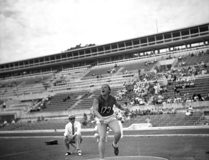 FILE - In this Sept. 2, 1960 file photo, Tamara Press of Russia heaves the shot during the Women's shot put qualifying round at the Summer Olympic Games in Rome, Italy. Three-time Olympic champion Tamara Press has died at the age of 83. The Russian track federation says Press died in the hospital on April 26, 2021 without giving a cause of death. Press competed for the Soviet Union and won gold in the shot put and silver in the discus at the 1960 Rome Olympics. She won gold in both events four years later at the 1964 Tokyo Games. (AP Photo, file)