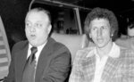 File-This Oct. 10, 1977, file photo shows  Los Angeles Dodgers manager Tom Lasorda, left, and pitcher Don Sutton riding together on a bus taking them to New York's Yankee Stadium, Oct. 10, 1977.  Sutton, a Hall of Fame pitcher who was a stalwart of the Los Angeles Dodgers' rotation spanning an era from Sandy Koufax to Fernando Valenzuela, died Tuesday, Jan. 19, 2021. He was 75. The Baseball Hall of Fame in Cooperstown, New York, said Sutton died at his home in Rancho Mirage, California, after a long struggle with cancer. The Atlanta Braves, where Sutton was a long-time broadcaster, said he died in his sleep.  (AP Photo/Ray Howard, File)