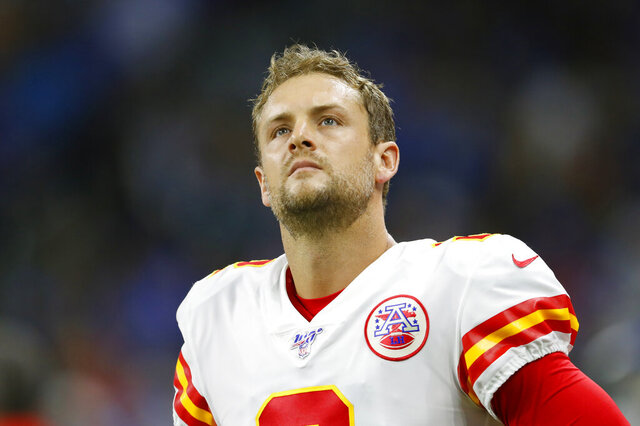 "FILE - In this Sept. 29, 2019, file photo, Kansas City Chiefs punter Dustin Colquitt (2) watches during an NFL game against the Detroit Lions in Detroit. The Kansas City Chiefs are releasing two-time Pro Bowl punter Dustin Colquitt, whose 15-year career with the franchise allowed him to set numerous club records, including the most games played and most postseason appearances. Colquitt, who turns 38 next month, posted a farewell on Instagram late Monday, April 27, 2020, in which he said that ""all things come to an end, sometimes sooner than you hoped, prayed and pleaded for them to."" A person familiar with the team's decision confirmed it to The Associated Press on condition of anonymity Tuesday because it had not been announced. (AP Photo/Paul Sancya, Fle)"