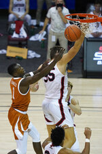 Texas guard Andrew Jones (1) goes up for a basket against Davidson forward Luka Brajkovic (35) in the first half of an NCAA college basketball game in the Maui Invitational tournament, Monday, Nov. 30, 2020 in Asheville, N.C. (AP Photo/Kathy Kmonicek)