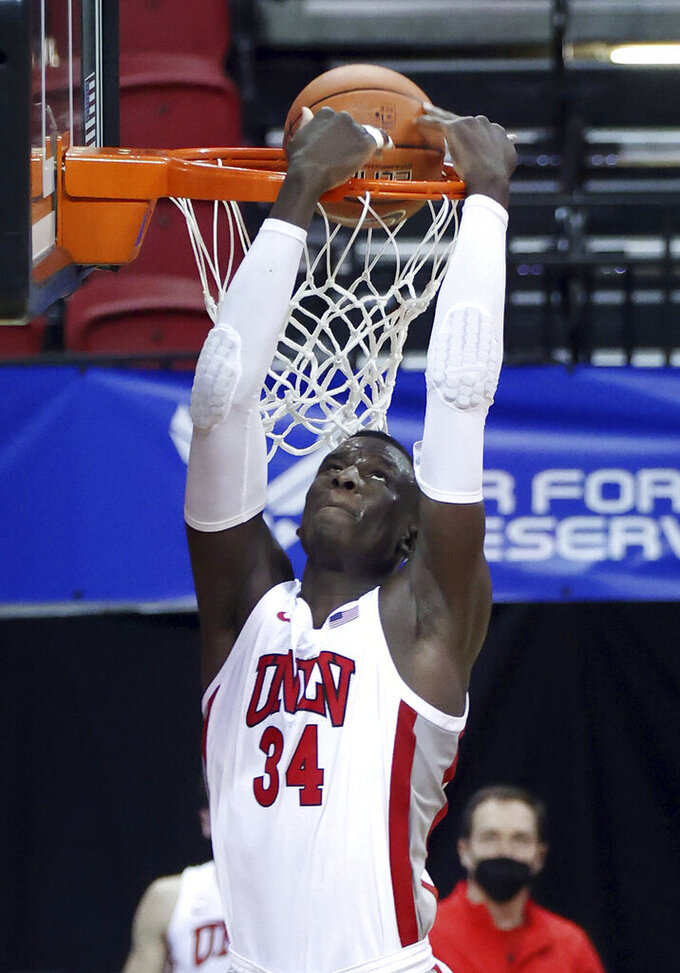 UNLV forward Cheikh Mbacke Diong (34) dunks against Air Force during the second half of an NCAA college basketball game in the first round of the Mountain West Conference tournament Wednesday, March 10, 2021, in Las Vegas. (AP Photo/Isaac Brekken)