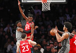 Brooklyn Nets guard Caris LeVert, far left, tries to pass to Brooklyn Nets center Jarrett Allen, second from right, around Toronto Raptors forward Chris Boucher (25) as Raptors forward Pascal Siakam (43) defends against the pass during the second quarter of an NBA basketball game, Wednesday, Feb. 12, 2020, in New York. (AP Photo/Kathy Willens)