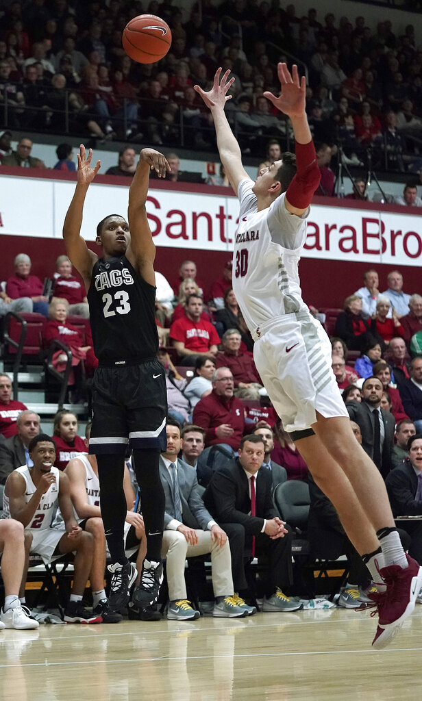 Gonzaga guard Zach Norvell Jr. (23) takes a 3-point shot over Santa Clara forward Guglielmo Caruso during the first half of an NCAA college basketball game Thursday, Jan. 24, 2019, in Santa Clara, Calif. (AP Photo/Tony Avelar)