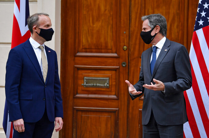 Britain's Foreign Secretary Dominic Raab, left, poses for a photo with U.S. Secretary of State Antony Blinken ahead of bilateral talks as part of the G7 foreign ministers meeting near London, Monday May 3, 2021.  Issues related to Iran are set to feature in talks later Monday between U.S. Secretary of State Antony Blinken and his host in London, British Foreign Secretary Dominic Raab. (Ben Stansall / Pool via AP)