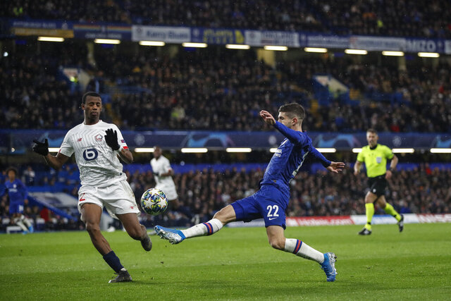 Chelsea's Christian Pulisic controls the ball next to Lille's Tiago Djalo during the Champions League Group H soccer match between Chelsea and Lille at Stamford Bridge stadium in London ,Tuesday, Dec.10, 2019. (AP Photo/Thanassis Stavrakis)