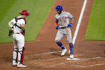 New York Mets' Kevin Pillar (11) arrives home after hitting a two-run home run as St. Louis Cardinals catcher Andrew Knizner watches during the third inning of a baseball game Monday, May 3, 2021, in St. Louis. (AP Photo/Jeff Roberson)