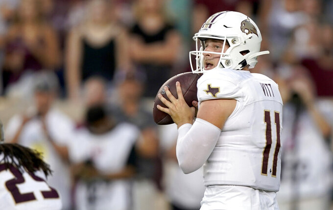 Texas State quarterback Tyler Vitt (11) looks to pass against Texas A&M during the first half of an NCAA college football game Thursday, Aug. 29, 2019, in College Station, Texas. (AP Photo/Sam Craft)