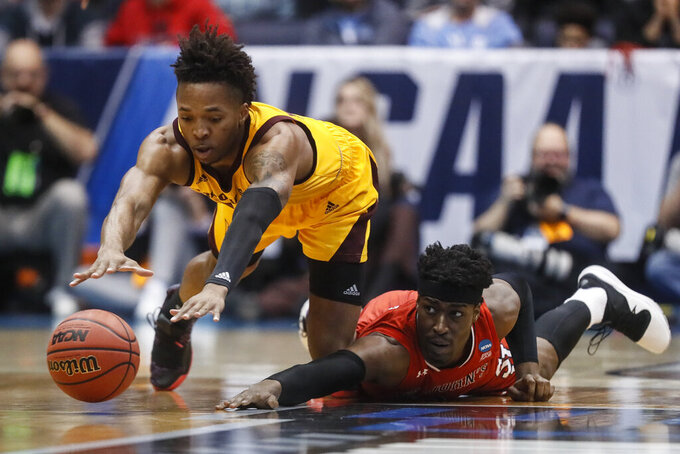 Arizona State's Kimani Lawrence, left, and St. John's Sedee Keita, right, dive for a loose ball during the first half of a First Four game of the NCAA men's college basketball tournament, Wednesday, March 20, 2019, in Dayton, Ohio. (AP Photo/John Minchillo)