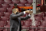 Alabama head coach Nate Oats cuts the net after an NCAA college basketball game against Auburn, Tuesday, March 2, 2021, in Tuscaloosa, Ala. Alabama won the regular season Southeastern Conference championship. (AP Photo/Vasha Hunt)