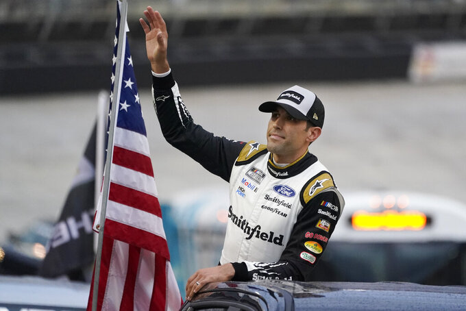 Aric Almirola waves to fans before a NASCAR Cup Series auto race at Bristol Motor Speedway Saturday, Sept. 18, 2021, in Bristol, Tenn. (AP Photo/Mark Humphrey)