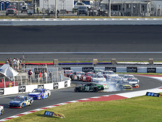Brandon Jones (19) spins in Turn 6 as other cars drive by during a NASCAR Xfinity Series auto race at Charlotte Motor Speedway, Saturday, Sept. 28, 2019 in Concord, N.C. (AP Photo/Mike McCarn)