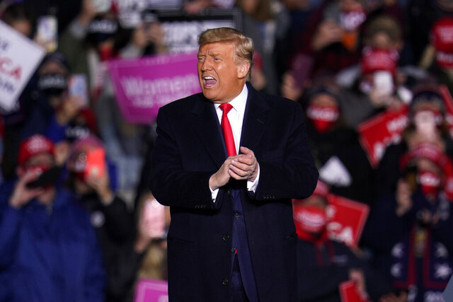 President Donald Trump acknowledges his supporters after speaking at a campaign rally at Erie International Airport, in Erie, Pa, Tuesday, Oct. 20, 2020. (AP Photo/Gene J. Puskar)