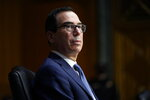 Treasury Secretary Steven Mnuchin listens during a Senate Banking Committee hearing on 'The Quarterly CARES Act Report to Congress' on Capitol Hill in Washington, Tuesday, Dec. 1, 2020. (AP Photo/Susan Walsh, Pool)