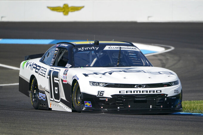 AJ Allmendinger (16) drives through a turn during qualifying for the NASCAR Xfinity Series auto race at Indianapolis Motor Speedway in Indianapolis, Saturday, Aug. 14, 2021. (AP Photo/Michael Conroy)