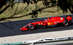 Ferrari driver Charles Leclerc of Monaco steers his car during qualification for the Formula One Portuguese Grand Prix at the Algarve International Circuit in Portimao, Portugal, Saturday, Oct. 24, 2020. The Formula One Portuguese Grand Prix will take place on Sunday. (AP Photo/Armando Franca, Pool)