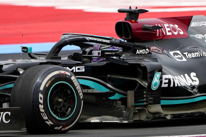 Mercedes driver Lewis Hamilton of Britain takes a curve during the French Formula One Grand Prix at the Paul Ricard racetrack in Le Castellet, southern France, Sunday, June 20, 2021. (AP Photo/Francois Mori)