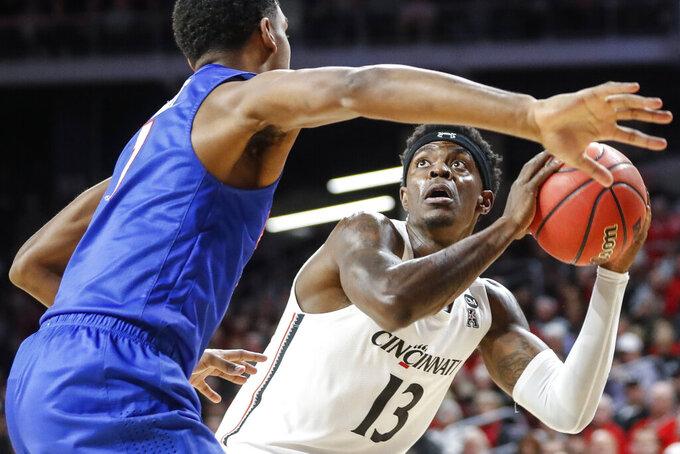 Cincinnati's Tre Scott (13) eyes the basket as SMU's Feron Hunt (1) defends during the first half of an NCAA college basketball game Tuesday, Jan. 28, 2020, in Cincinnati. (AP Photo/John Minchillo)