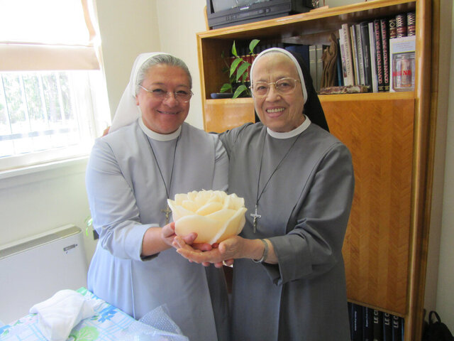 This undated photo provided by Sister Maria Mabel Spagnuolo shows her, left, with Sister Maria Ortensia Turati. On March 16, 2020, Turati, who was the former mother general of the Little Missionary Sisters of Charity in Tortona, Italy, died at age 88 as a result of the COVID-19 coronavirus. (Courtesy Sister Maria Mabel Spagnuolo via AP)
