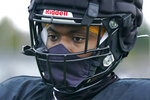Nasier Ford, a freshman defensive lineman at Pacific Lutheran, wears a mask that is integrated into his football helmet, during practice Tuesday, Feb. 2, 2021, in Tacoma, Wash. For all the attention heaped on the FBS level of college football last fall as it tried to play, it will not be the only college football during the 2020-21 sports calendar as a handful of NCAA Division III and NAIA programs begin some form of a winter/spring season Saturday, Feb. 6. (AP Photo/Ted S. Warren)