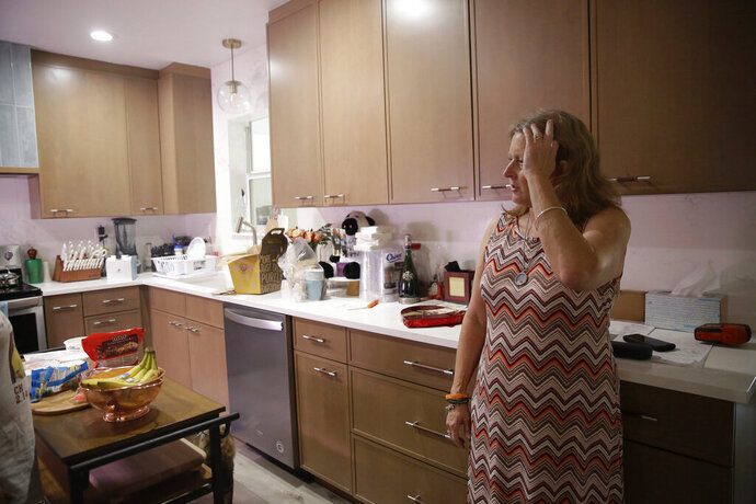 Debbi Hixon, speaks during an interview with The Associated Press on Friday, Feb. 14, 2020, in Hollywood, Fla. Her husband Chris Hixon was killed in a school shooting on Valentine's Day two years ago at Marjory Stoneman Douglas High School. She recently had the family home renovated by the program