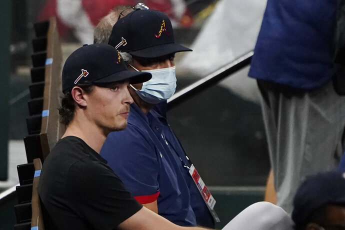 Atlanta Braves' pitcher Max Fried, scheduled to pitch in Game 1 of the National League Championship Series against the Los Angeles Dodgers, watches as the Dodgers work out in Arlington, Texas, Sunday, Oct 11, 2020. The series begins Monday, Oct. 12. (AP Photo/Sue Ogrocki)